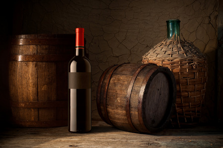 wooden barrel: Wine glass on vineyard background