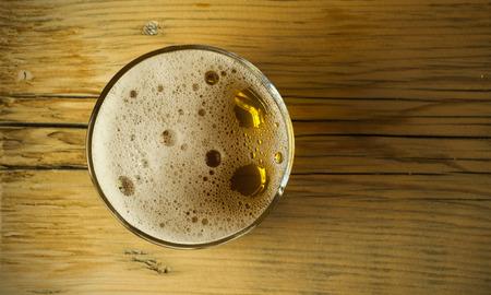 unbottled: Beer barrel with beer glasses on table on wooden background