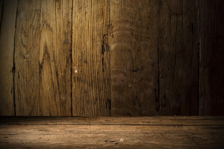 dark background: background of barrel and worn old table of wood