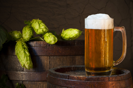 unbottled: Still Life with a keg of beer and draft beer by the glass. Stock Photo