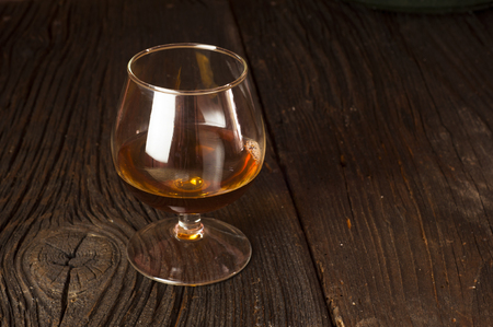 butch: Glasses of brandy in cellar with old barrels