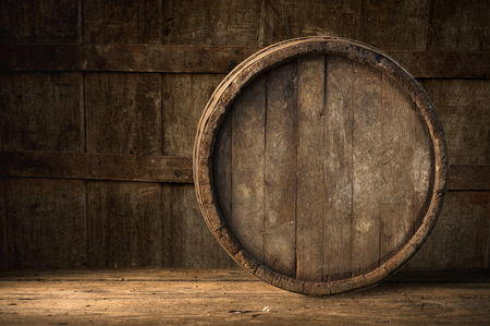 wine barrel: Beer barrel with beer glass on table on wooden background