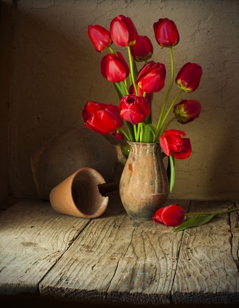 Still life with tulips bouquet on wooden table Stock Photo