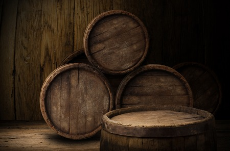 beer pint: Beer barrel with beer glasses on a wooden table. The dark background. Stock Photo