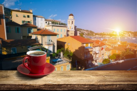 city of sunrise: background with cup of coffee in europe Stock Photo