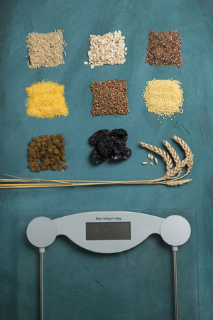 losing control: Diet. Top View Of Female Bare Feet Standing On A Scale Stock Photo
