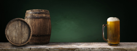 background of barrel, beer and worn old table of wood Stock Photo