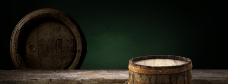 background of barrel and worn old table of wood. Stock Photo