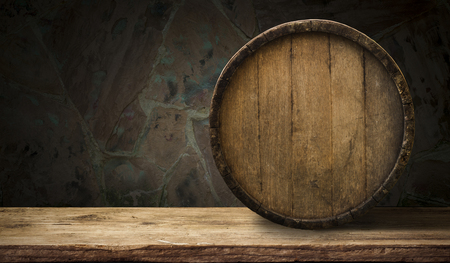 white wood floor: background of barrel and worn old table of wood. Stock Photo