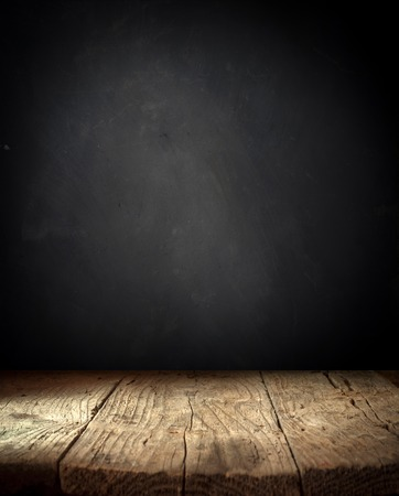 Old wood table top with smoke in the dark background 写真素材