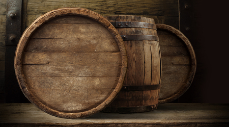 background of barrel and worn old table of wood. 写真素材