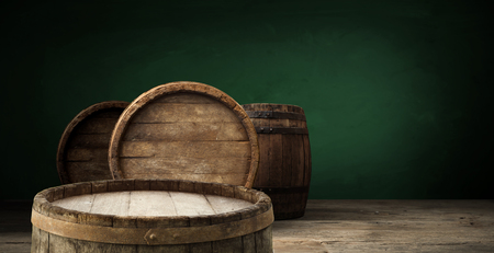 background of barrel and worn old table of wood. Stockfoto
