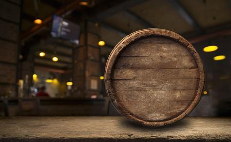 Beer barrel with beer glasses on a wooden table. The dark brown background. Reklamní fotografie