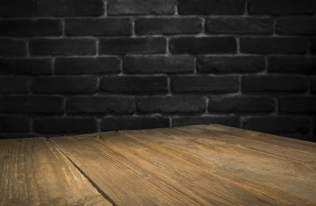 Old wooden table with brick background Stockfoto - 123119589
