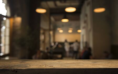 image of wooden table in front of abstract blurred background of resturant lights Zdjęcie Seryjne