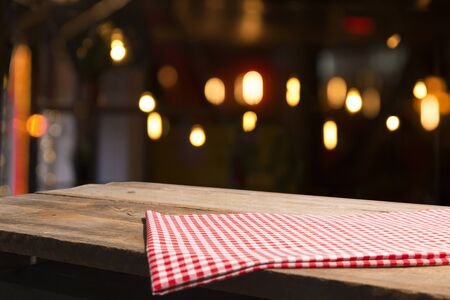 Table background with napkin and blurred bar background space