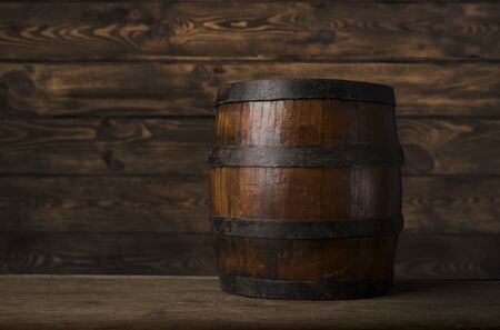 Old wooden barrel on a brown background Reklamní fotografie