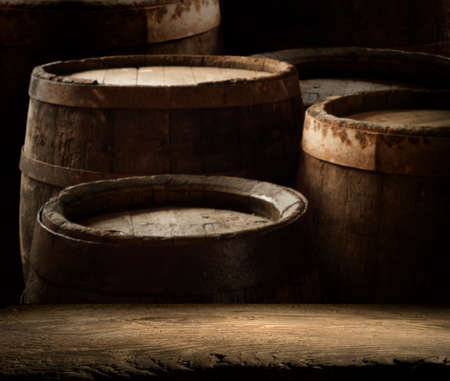Old wooden barrel on a brown background Archivio Fotografico