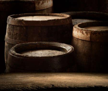 Old wooden barrel on a brown background Stock fotó