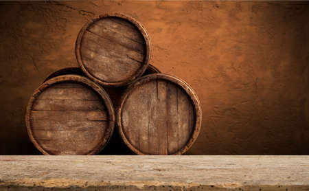 Beer barrel with beer glasses on a wooden table. The dark brown background. Stock Photo