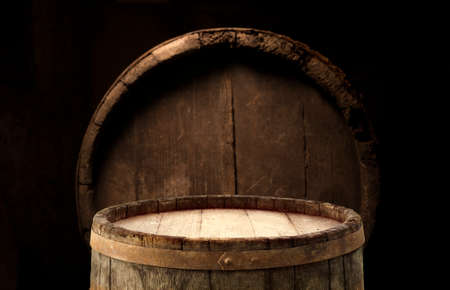 Wooden barrel on a table and textured background Reklamní fotografie