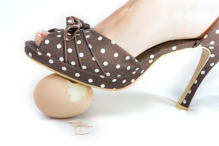 trample: High heel shoe crushing an egg