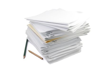 beetwen: A pile of papers on a white backgrund Stock Photo
