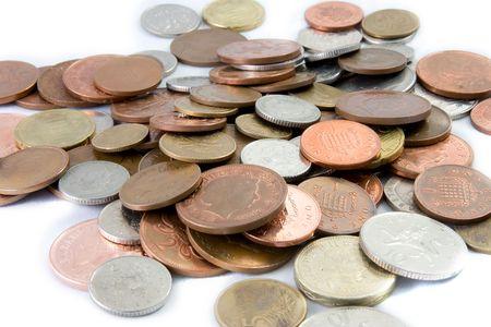 oxidated: Monedas diferentes sobre un fondo blanco Foto de archivo