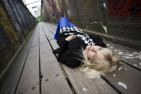A model lying on an old bridge photo