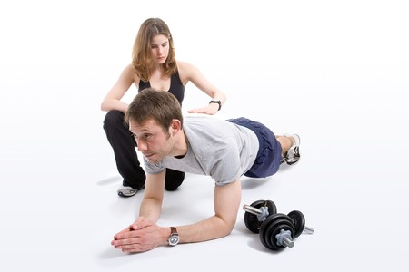 personal trainer: Female trainer working with her trainee
