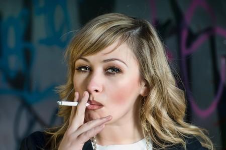 smoker: Beautiful woman smoking a cigarette