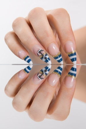 Female hand with a marine style manicure Stock Photo