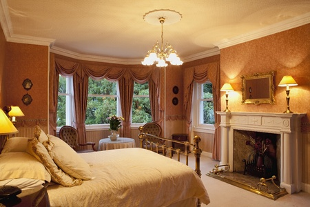Luxury victorian bedroom with a fireplace Stock Photo