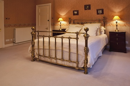 Great king size bed in a luxurious bedroom photo
