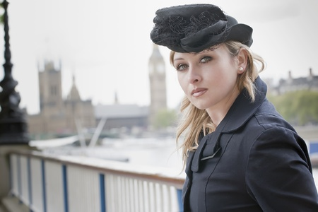 Elegant woman posing in front of the Big Ben in London photo