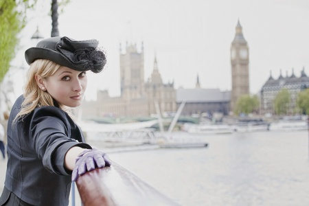 Beautiful woman  in London, with Big Ben in background Standard-Bild