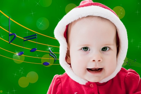christmas carols: Baby singing Christmas carols Stock Photo