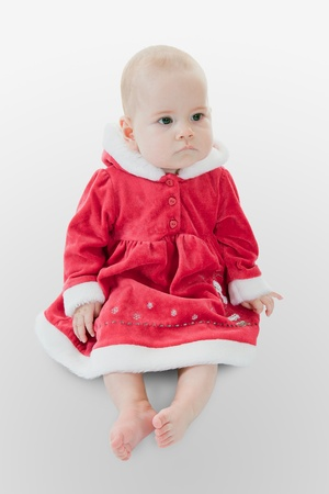 Cute baby girl  in a Christmas dress photo