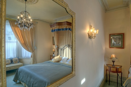Luxurious bedroom reflected in a mirror