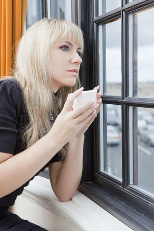 Beautiful woman having her morning cup of tea Stock Photo - 11717918