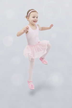 Adorable little girl during her ballet lesson photo