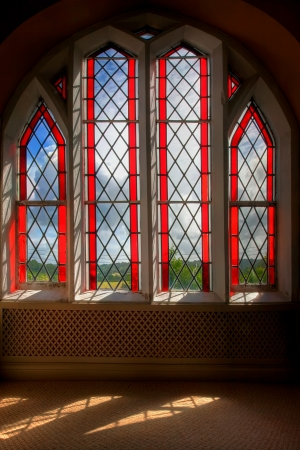 stained glass window: Sun shinning through a stained-glass window Stock Photo
