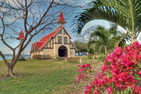 Beautiful red roofed church in Mauritius Stock Photo
