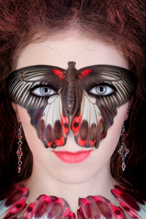 Beautiful lady in a butterfly mask photo