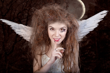 deceitful: Beautiful angel with horns, fantasy tale