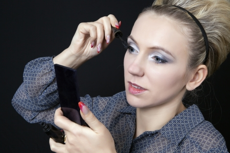 corrections: Young beautiful woman applying corrections to her make-up