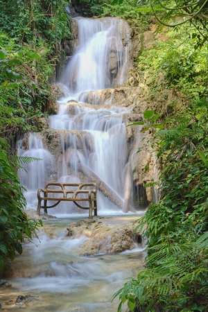 Waterfall and bench in a beautiful Jamaican park photo