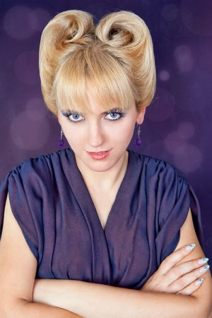 avantegarde: Beautiful woma dressed in purple with a funky hairdo Stock Photo