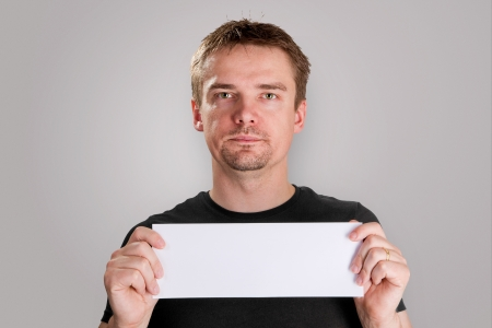 Man holding blank piece of paper Stock Photo - 18065579