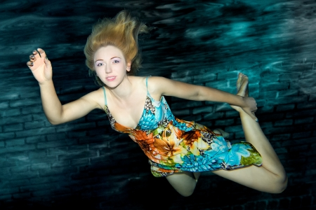 Underwater portrait of a beautiful woman
